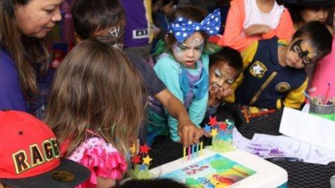GM Kura Productions, Karen Waaka-Tibble & tamariki cutting Pūkoro cake - Photo / file
