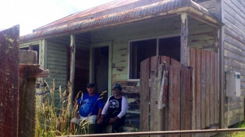 Tame Iti outside one of the oldest houses in Taneatua set for a makeover