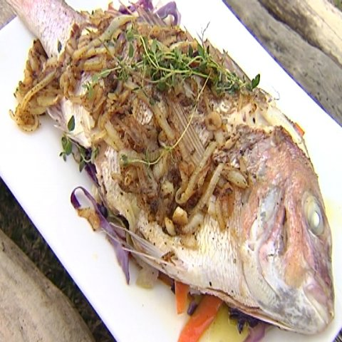 Cooked snapper presented on plate